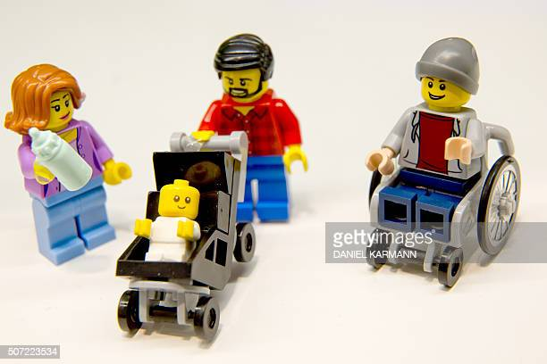 Lego figurines including one in a wheelchair are pictured at the Lego booth on January 28 2016 in Nuernberg during the 67th International Toy Fair /...
