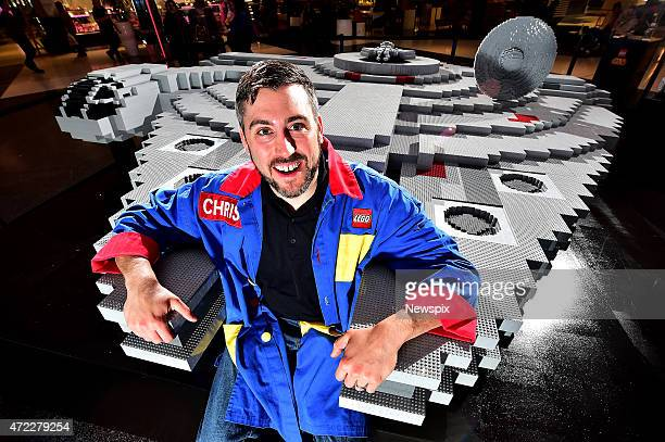 Lego Master Builder Chris Steininger poses next to the world's largest Lego model of the iconic Star Wars spaceship the Millennium Falcon at...