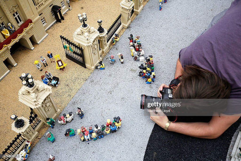 Lego models of the Royal family and well-wishers outside a model of Buckingham Palace, part of a new attraction created to commemorate the birth of HRH Prince George of Cambridge at the Legoland resort on July 25, 2013 in Windsor, England. Model maker Katrina James constructed the baby and pram model out of 55 bricks, with the palace made out of 36,000 bricks. Catherine, Duchess of Cambridge gave birth to HRH Prince George of Cambridge at 16.24 BST on Monday July 22, 2013 with Prince William, Duke of Cambridge at her side.