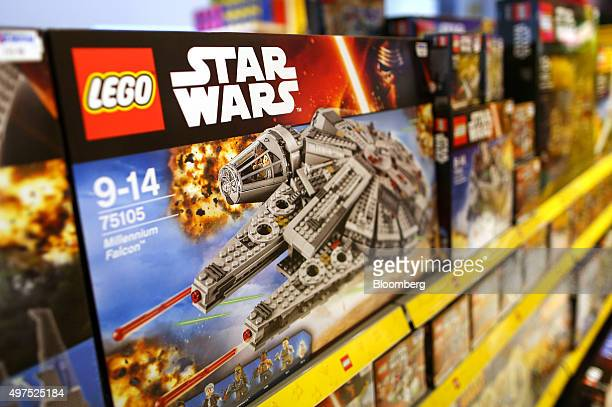 Lego Star Wars Millennium Falcon toy, manufactured by Lego A/S, stands on display at a toy store in London, U.K., on Tuesday, Nov. 17, 2015. U.K....