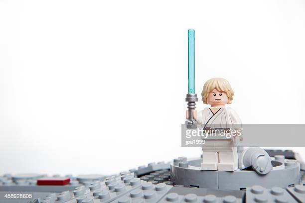 lego star wars toy character: luke skywalker. - lightsaber stock pictures, royalty-free photos & images