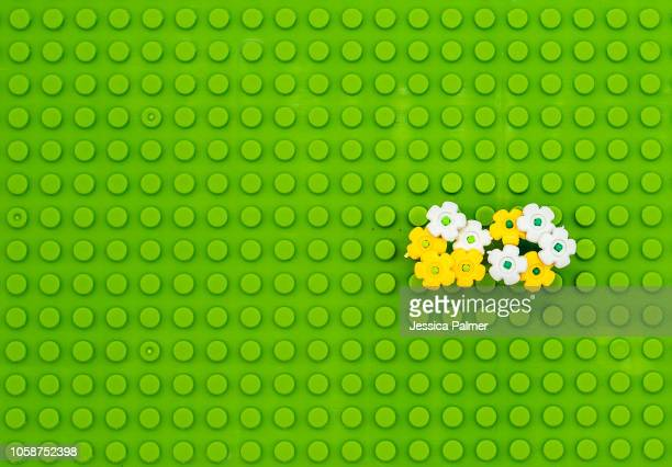 lego style grass and flowers conceptual nature - lego foto e immagini stock