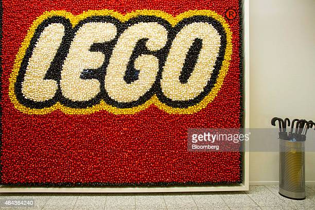 Lego toy figures form the company logo beside an umbrella stand in the reception area at the headquarters of Lego A/S in Billund Denmark on Wednesday...