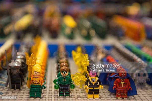 Lego toys in the likeness of superhero characters are seen on a vendor table during the Wizard World St Louis Comic Con at AmericaÕs Center on April...