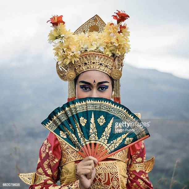 legong dancer on hillside infront of volcano - kintamani district stock pictures, royalty-free photos & images