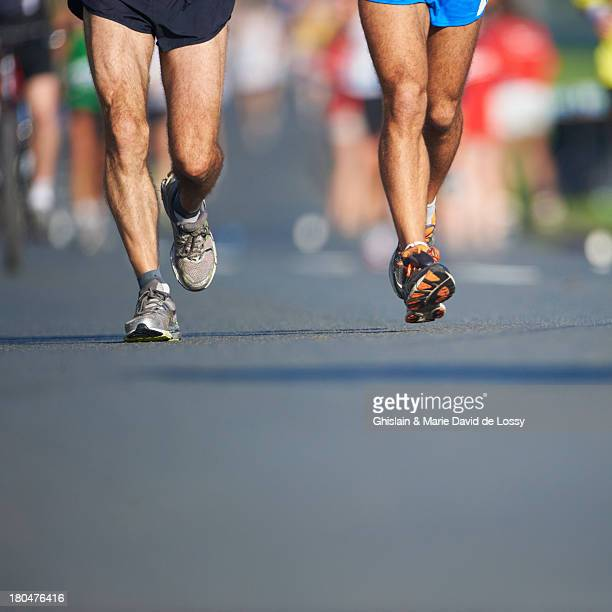 legs and feet of joggers, running a marathon - low section stock pictures, royalty-free photos & images