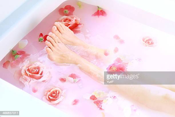 Legs and roses in hot bath.