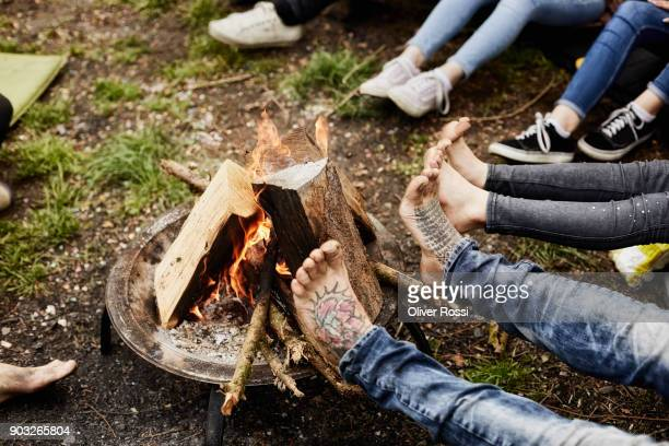 Legs around camp fire