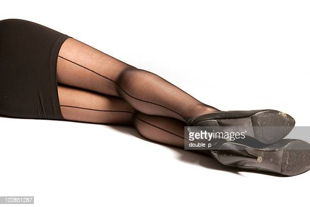 legs at rest - women in stockings and high heels stock photos and pictures