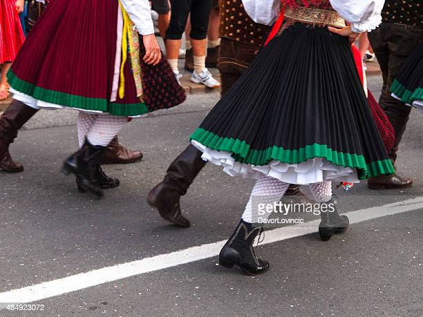 legs at villacher kirchtag, parade in villach, austria - folk music stock pictures, royalty-free photos & images