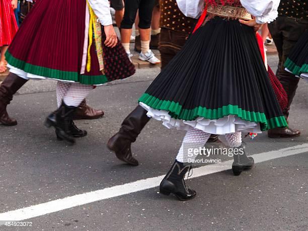 Legs at Villacher Kirchtag, parade in Villach, Austria