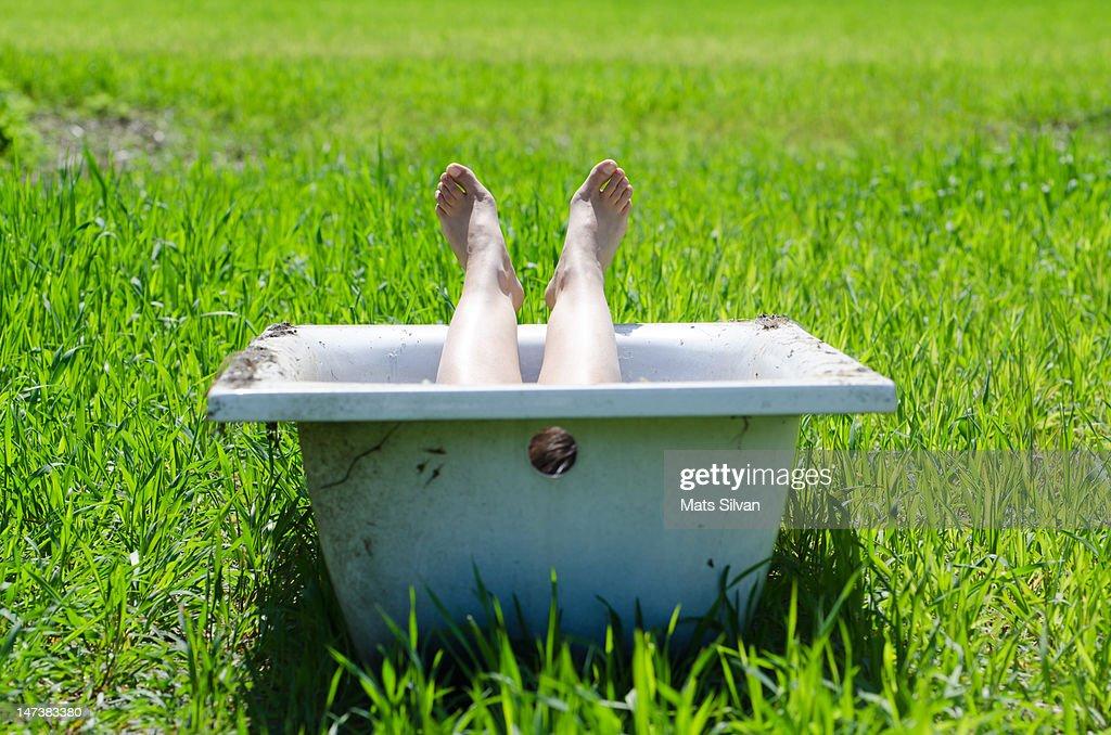 Legs in bathtub : Stock Photo