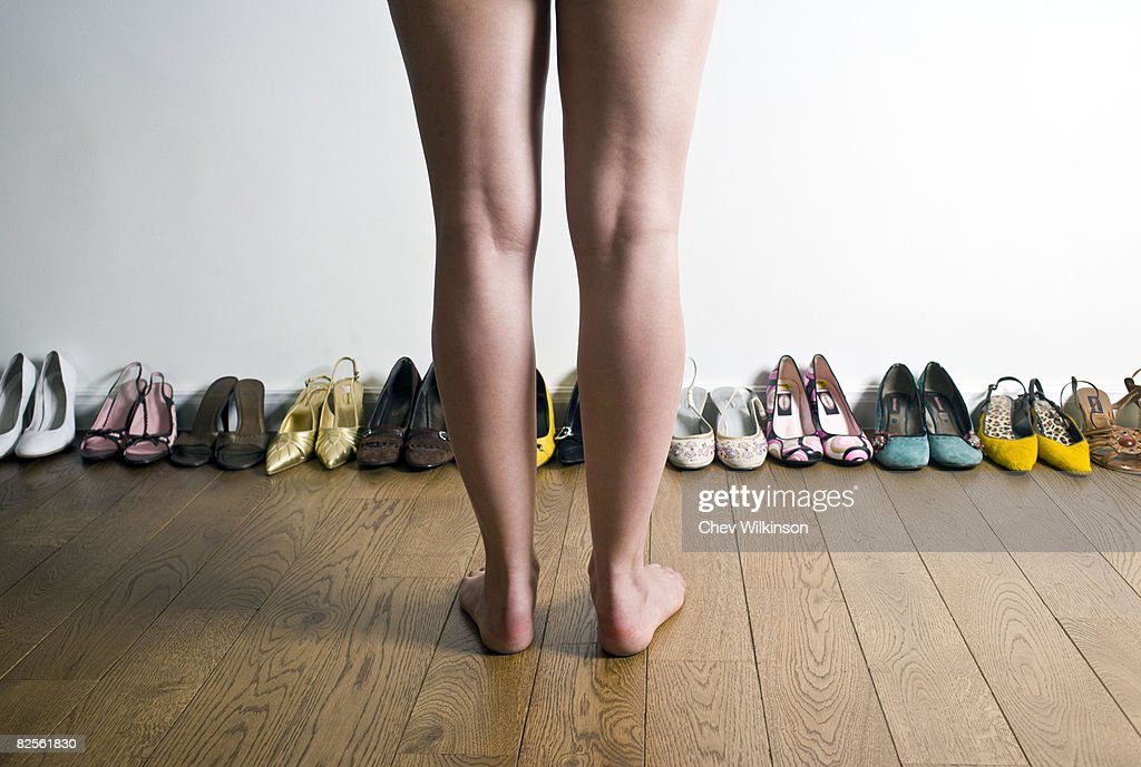 Legs in front of row of shoes : Stock Photo