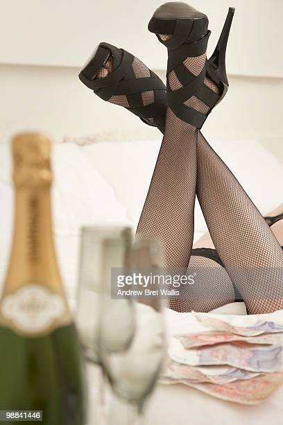 legs in stockings & heels, bank notes & champagne