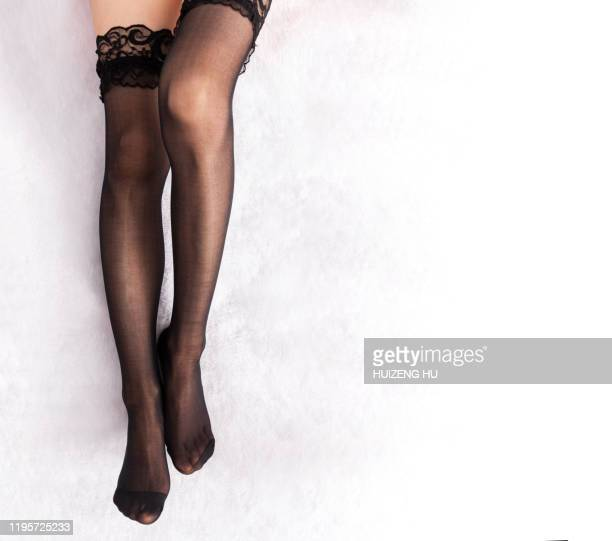 legs in stockings with copy space. fashion seductive pantyhose - black stockings stock pictures, royalty-free photos & images