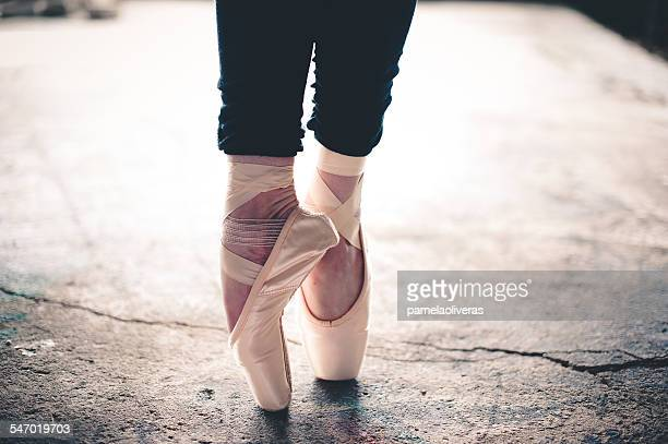 Legs of a ballet dancer standing en pointe