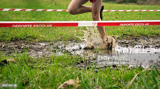 legs of a child running and splashing in a puddle mud. - human foot stock pictures, royalty-free photos & images