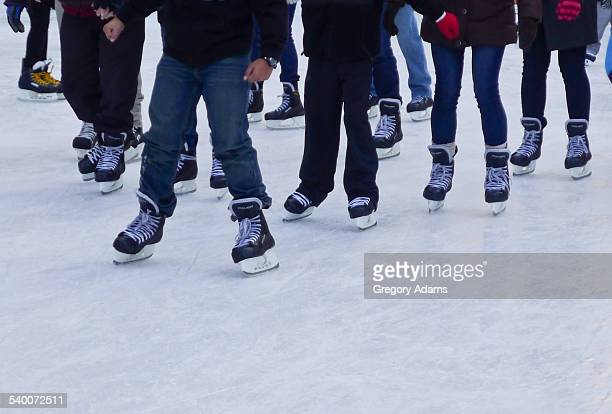 Legs of a group of ice skaters in Philadelphia