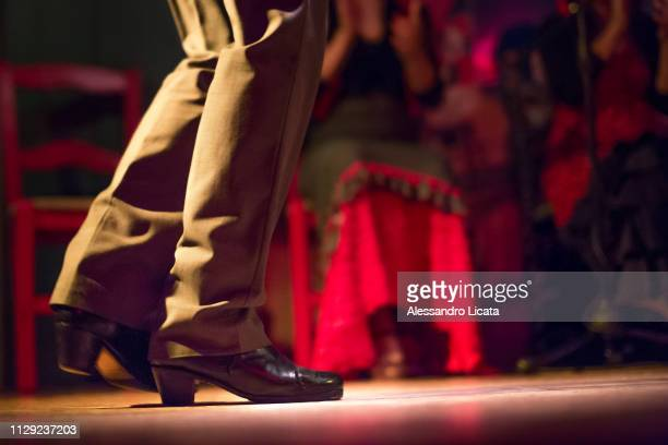 legs of a man who dance flamenco - flamenco stock photos and pictures