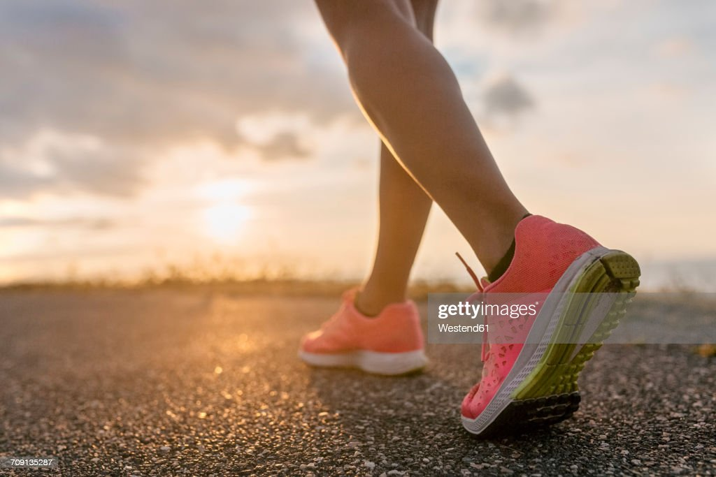 Legs of a running woman : Stock Photo