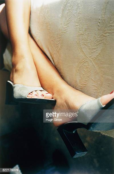 legs of a woman lying on bed - hugh sitton stockfoto's en -beelden
