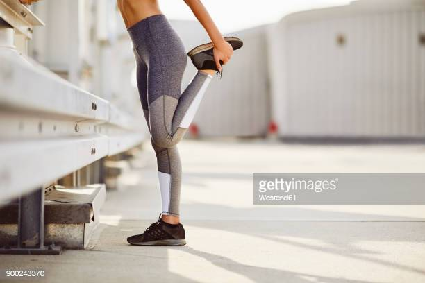 legs of a woman stetching - warming up stock pictures, royalty-free photos & images