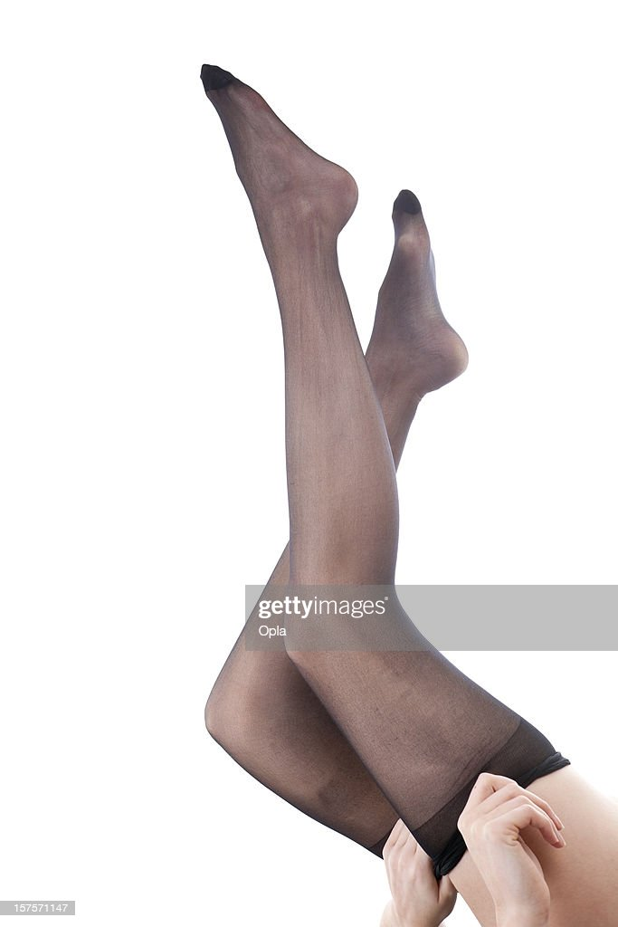Legs of a young woman donning black panties : Stock Photo