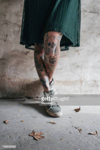 Legs of a young woman with tattoos