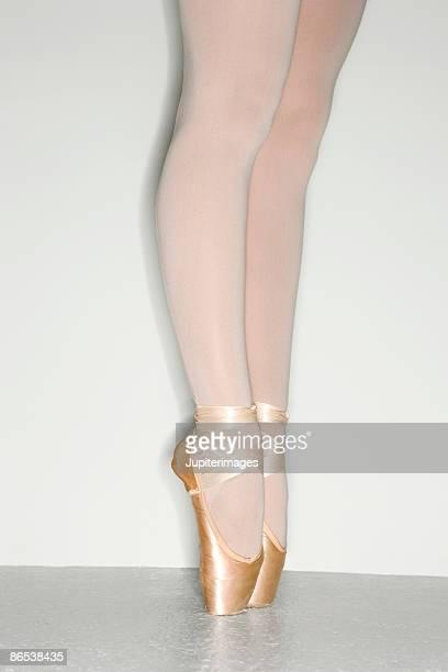 Legs of ballerina standing en pointe