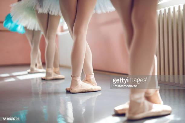 legs of ballerinas in a row - barre class stock photos and pictures