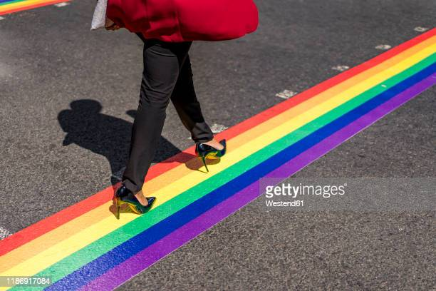 legs of businesswoman crossing the street on lgbt stripes, london, uk - striped blazer stock pictures, royalty-free photos & images