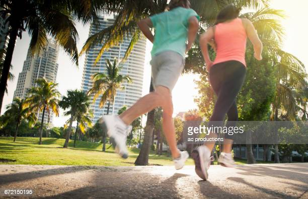 legs of caucasian women jogging in city - city_(florida) stock pictures, royalty-free photos & images
