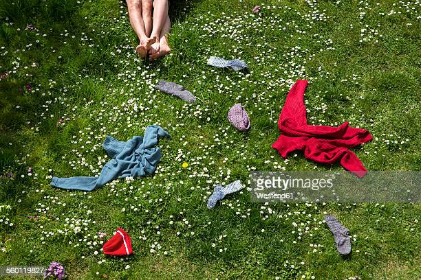 Legs of couple lying in spring meadow