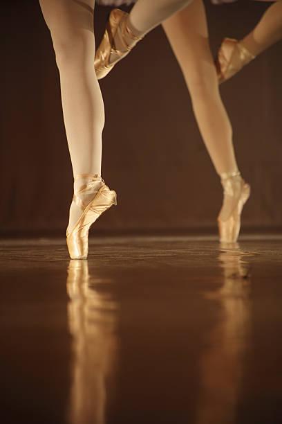 Legs of dancing ballerinas - balet background