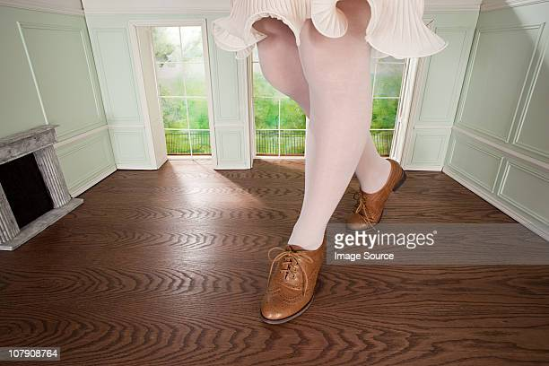 legs of giant woman in tiny room - big foot stock photos and pictures