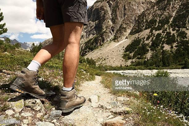 legs of hiker in the Alps