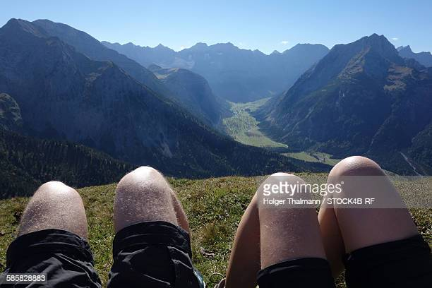 Legs of hikers and mountainscape at Ahornboden, Karwendel, Tyrol, Austria