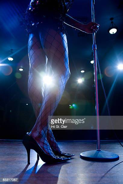 Legs of nightclub singer with stage Lights
