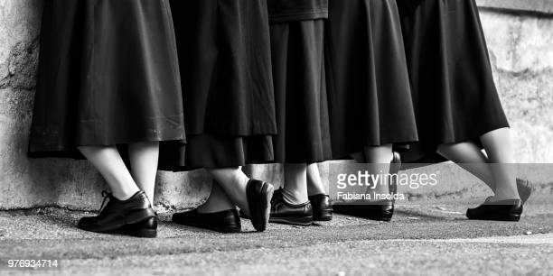 legs of nuns, italy, rome - nun stock pictures, royalty-free photos & images