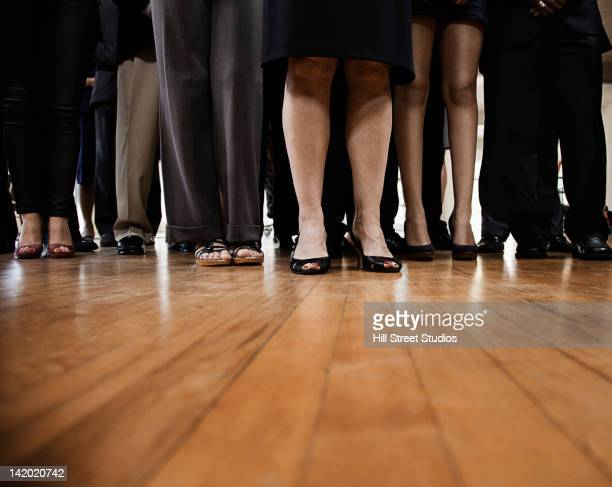 Legs of people gathered together