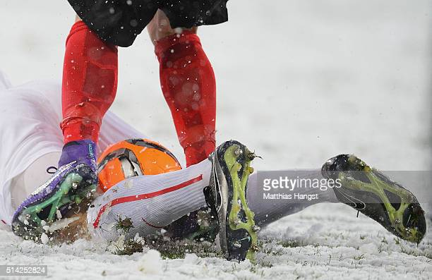 Legs of players with the ball in the snow seen during the Second Bundesliga match between SC Freiburg and RB Leipzig at SchwarzwaldStadion on March 7...