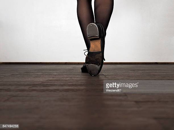 Legs of step dancing woman