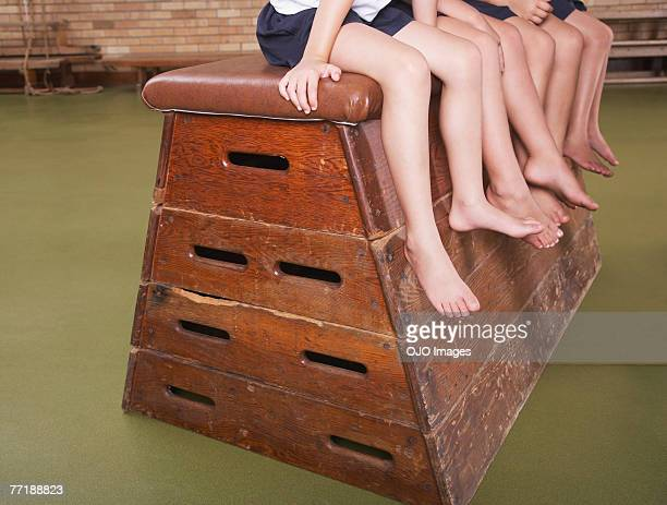Legs of students in gym class