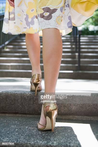 Legs of stylish woman on steps