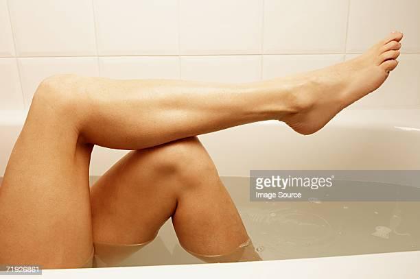 Legs of woman in the bath