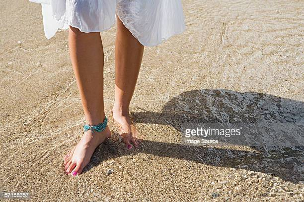 legs of woman on beach wearing anklet - anklet stock pictures, royalty-free photos & images