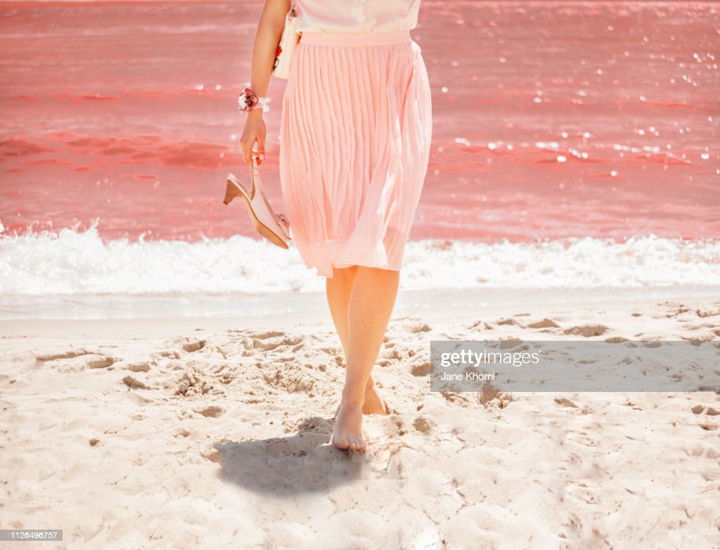 Legs of woman on the Living Coral sea shore. : Foto stock