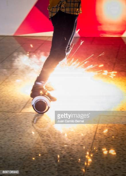 Legs of woman riding a burning hoverboard
