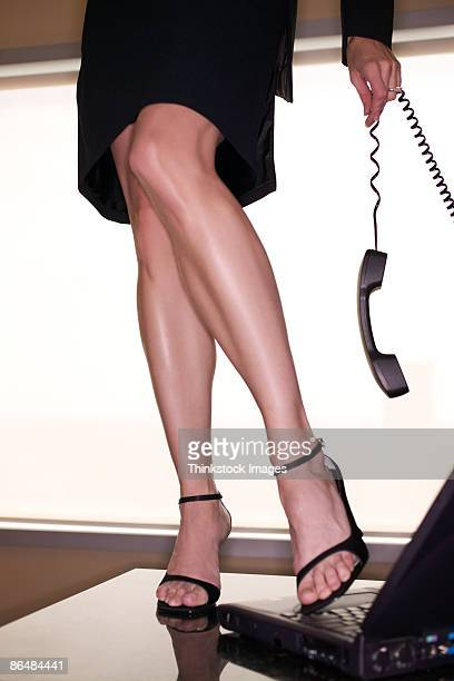 Legs of woman with phone