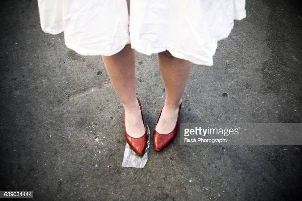 Legs of woman with red shoes in Berlin, Germany